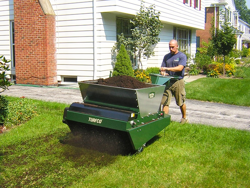 Topdress with any material-compost, sand, peat & crumb rubber.